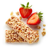 Granola bar. With fresh; strawberries and white chocolate  on white background Stock Images