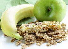 Granola bar, green apple and banana Royalty Free Stock Photo