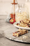 Granola bar on a grey rustic table Stock Photo
