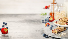 Granola bar on a grey rustic table. Healthy energy snack Royalty Free Stock Images