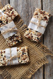 Granola bar. On a grey wooden table Royalty Free Stock Photo