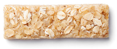 Granola bar muesli or cereal bar isolated on white. Top view of healthy oat granola bar muesli or cereal bar isolated on white background stock photos