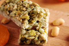 Granola bar on wooden board with dried fruits and nuts Royalty Free Stock Photos