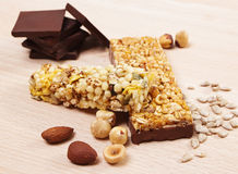Granola Bars. With Chocolate on wooden table Royalty Free Stock Photos
