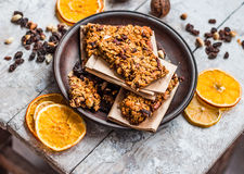 Granola bars citrus, peanut butter and dried fruit, healthy food Royalty Free Stock Photos