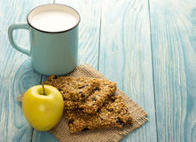 Granola bars with cup of milk Royalty Free Stock Photos