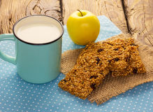 Granola bars with cup of milk Royalty Free Stock Images