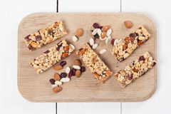 Granola bars with nuts, seeds and cranberries. Granola bars with various nuts, seeds and cranberries royalty free stock photography