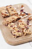 Granola bars with nuts, seeds and cranberries. Granola bars with various nuts, seeds and cranberries Stock Photo