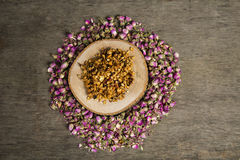 Granola. Bars served with flowers on wooden plate royalty free stock images