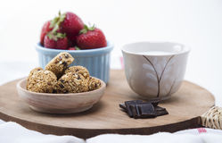 Granola. Bars served with fruits ,chocolate and milk royalty free stock photos