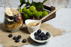 Granola. Bars served with fruits and honey royalty free stock image