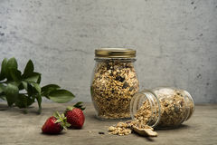Granola. Bars served in the jar with fruits royalty free stock photos