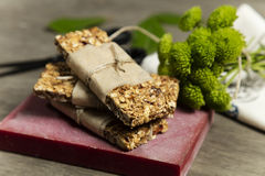 Granola. Bars served on red stone royalty free stock image