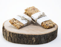 Granola. Bars served on wood plate stock image