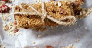 Granola bars tied with string on wax paper 4k. Close-up of granola bars tied with string on wax paper 4k stock footage