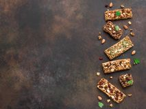 Granola bars. Various granola bars on dark rustic background, copy space. Homemade healthy snack - granola superfood bars royalty free stock image