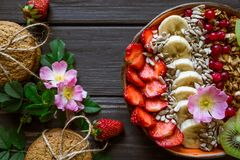 Granola, berries, biscuits and flowers 2 stock photos