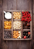 Granola, berries, nuts, dried fruit and milk. Healthy food in wooden box. Top view Royalty Free Stock Photography