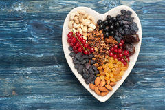 Granola, berries, nuts and dried fruits. Healthy breakfast ingredients. Top view Royalty Free Stock Photography