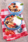 Granola, berries and yogurt Stock Photos