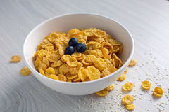 Granola with blueberries in white bowl on wooden Stock Photos