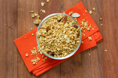 Granola in bowl with napkin. On brown background royalty free stock photo