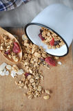 Granola bowl spilling on board Royalty Free Stock Photos