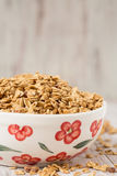 Granola Breakfast Cereal In Floral Bowl Royalty Free Stock Images