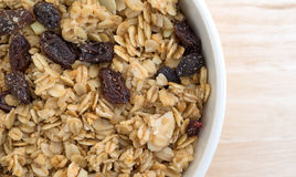 Granola cereal in bowl on wood table top close view Stock Photography