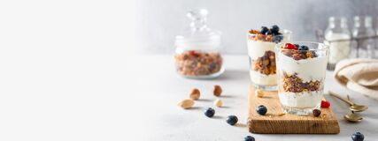 Free Granola, Cereal Breakfast Banner. Blueberry Parfait In Glasses On Wooden Board On Gray Background. Cafe, Restaurant, Confectionery Stock Images - 179265914