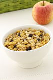 Granola cereal and fresh apple Stock Images