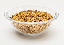 Granola cereal isolated on white backgroung. Granola cereal with dried frutis and nuts in a bowl isolated on white backgroung Royalty Free Stock Image