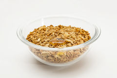 Granola cereal isolated on white backgroung. Granola cereal with dried frutis, nuts in a bowl and honey  isolated on white backgroung Stock Photography