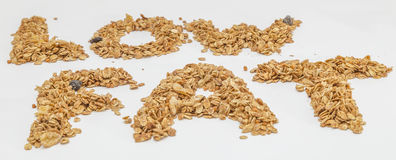 Granola cereal isolated on white backgroung. Granola cereal forming the word low fat isolated on white backgroung Stock Photography