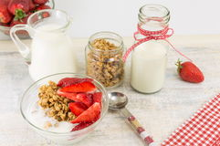 Granola cereals, fresh strawberries and bottle of milk Royalty Free Stock Image