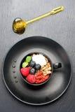 Granola with chia seeds, goji berries and honey Stock Photos