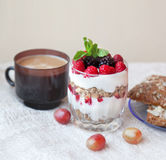 Granola with cream and fresh berries and cup of coffee, typical. Healthy breakfast Stock Image