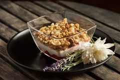 Granola dessert with vanilla and strawberry cream on wooden table - Close up Stock Photos