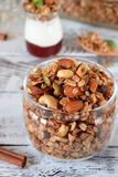 Granola with different nuts in a glass jar stock photos