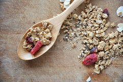 Granola with dried berry on spoon Royalty Free Stock Photography