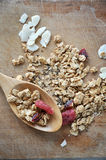 Granola with dried berry on wooden board Stock Image