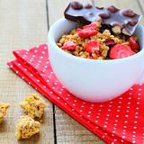 Granola with dried strawberries and chocolate Royalty Free Stock Image