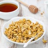 Granola e mel da abóbora Imagem de Stock Royalty Free