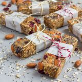 Granola energy bars with figs, oatmeal, almond, dry cranberry, chia and sunflower seeds, square format Royalty Free Stock Image