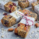 Granola energy bars with figs, oatmeal, almond, dry cranberry, chia and sunflower seeds, square format Stock Image