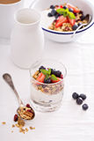 Granola with fresh berries in a blue bowl Royalty Free Stock Images