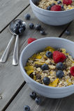 Granola with fresh berries. Breakfast. Granola with fresh berries on wooden background, healthy breakfast Royalty Free Stock Photo