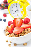 Granola with fresh berries, coffee and yellow alarm clock Royalty Free Stock Photos