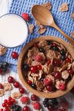 Granola with fresh berries and milk on the table. vertical top v Stock Images